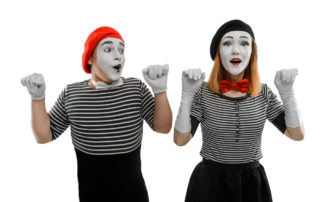 Photo of a man and woman mime